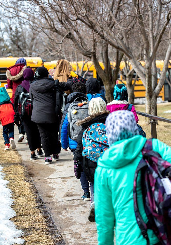 Kids walking to school buses